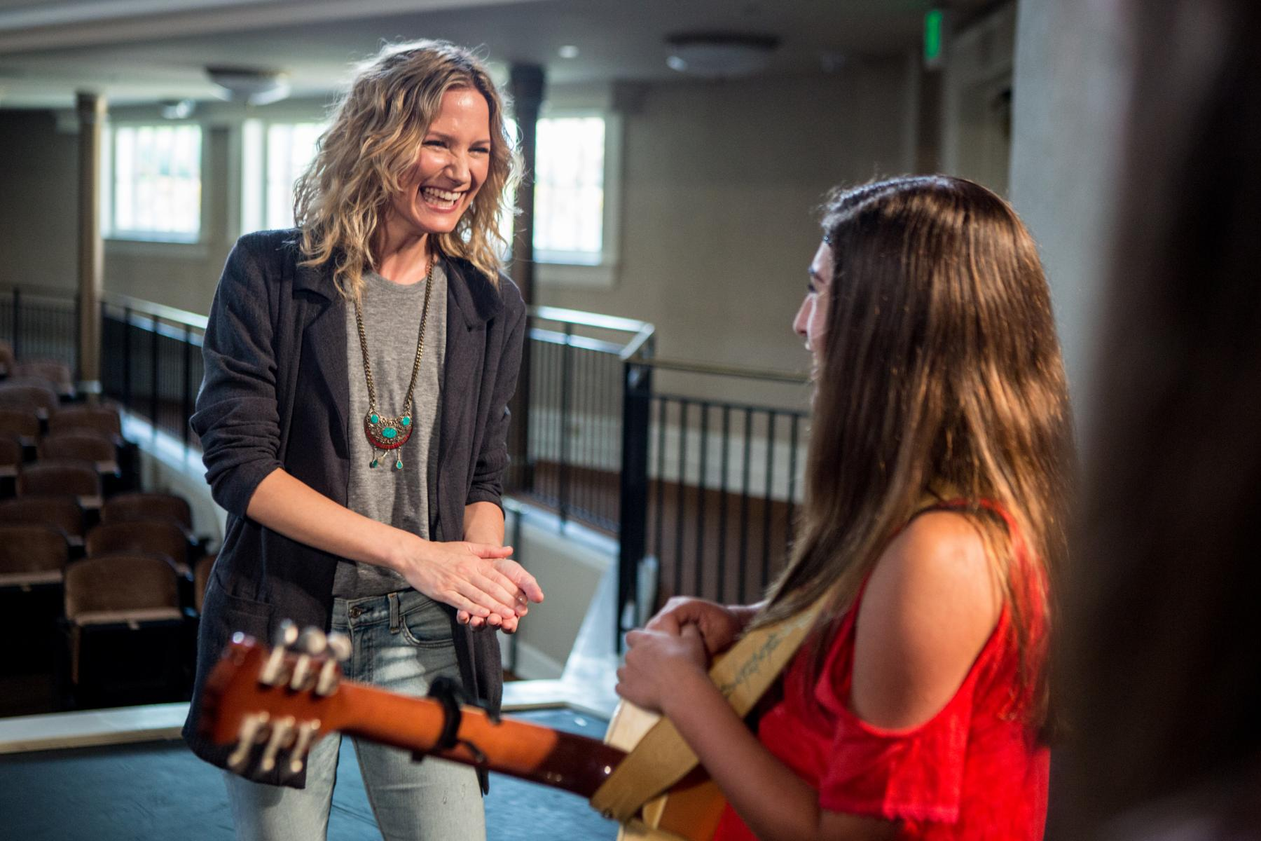 Jennifer Nettles laughing with teen