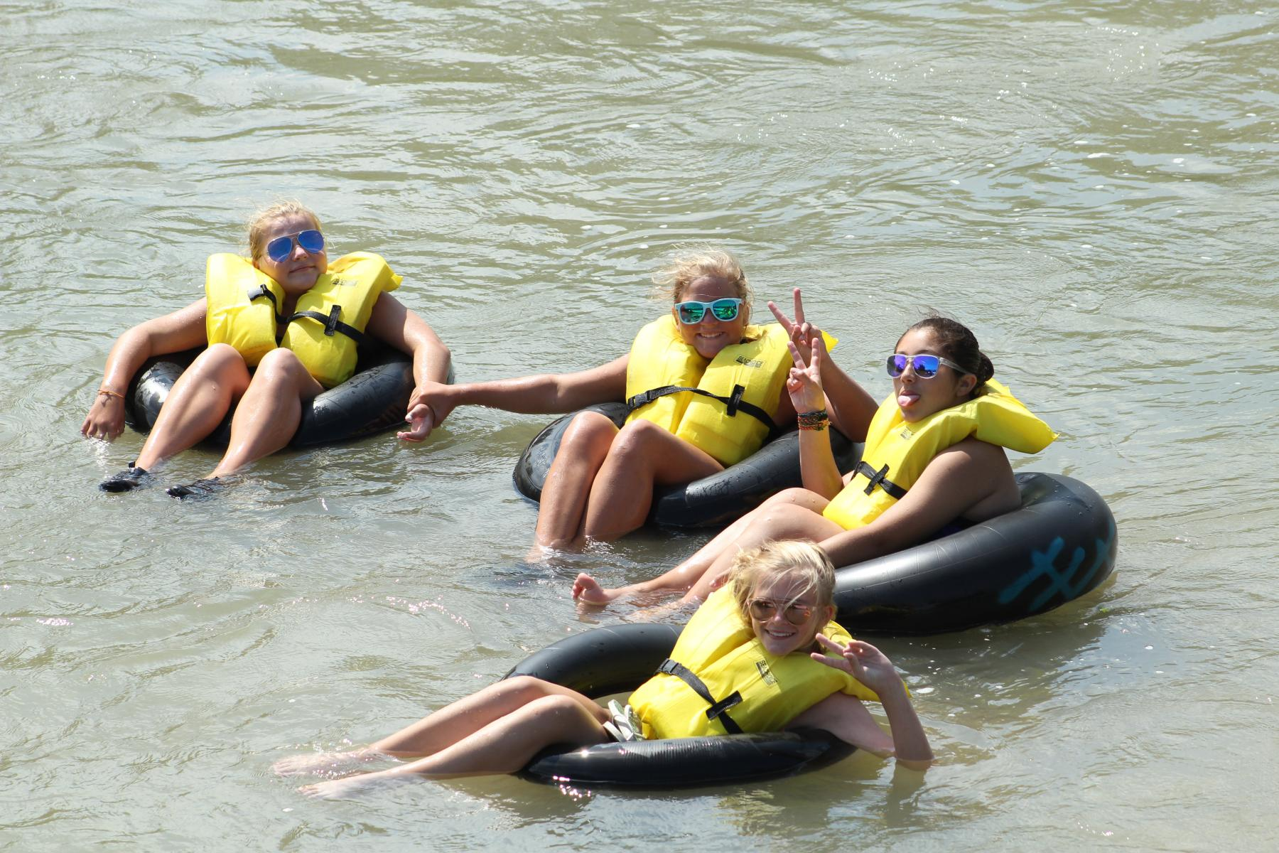 girls tubing down a river