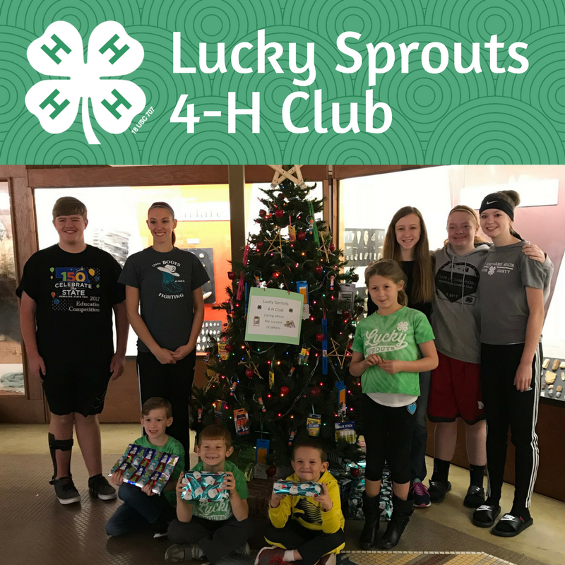 Lucky Sprouts 4-H Club members holding award certificates