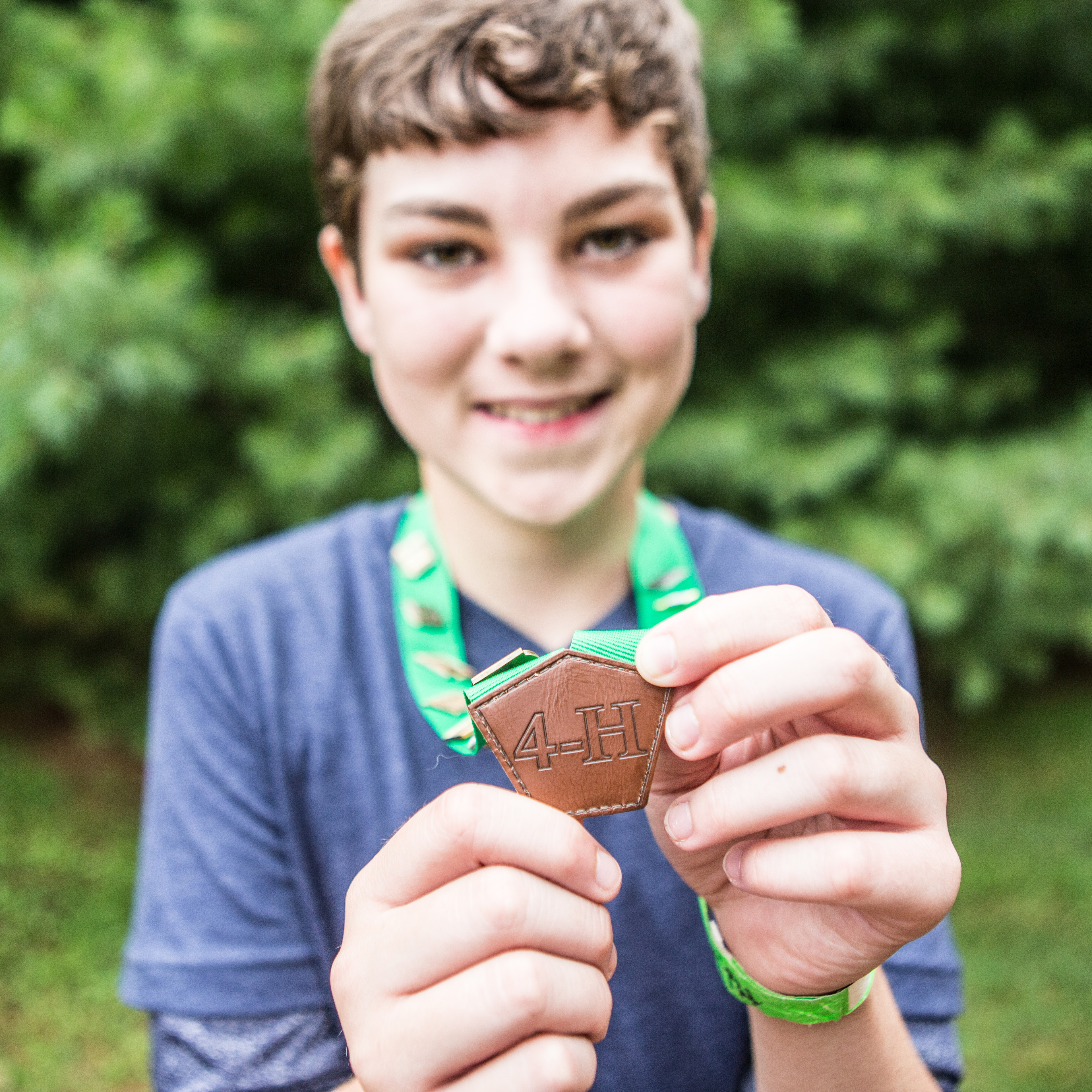 child holding 4-H award