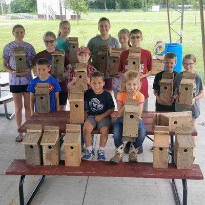 Sterling Livestock 4-H Club members pose with the birdhouses they built