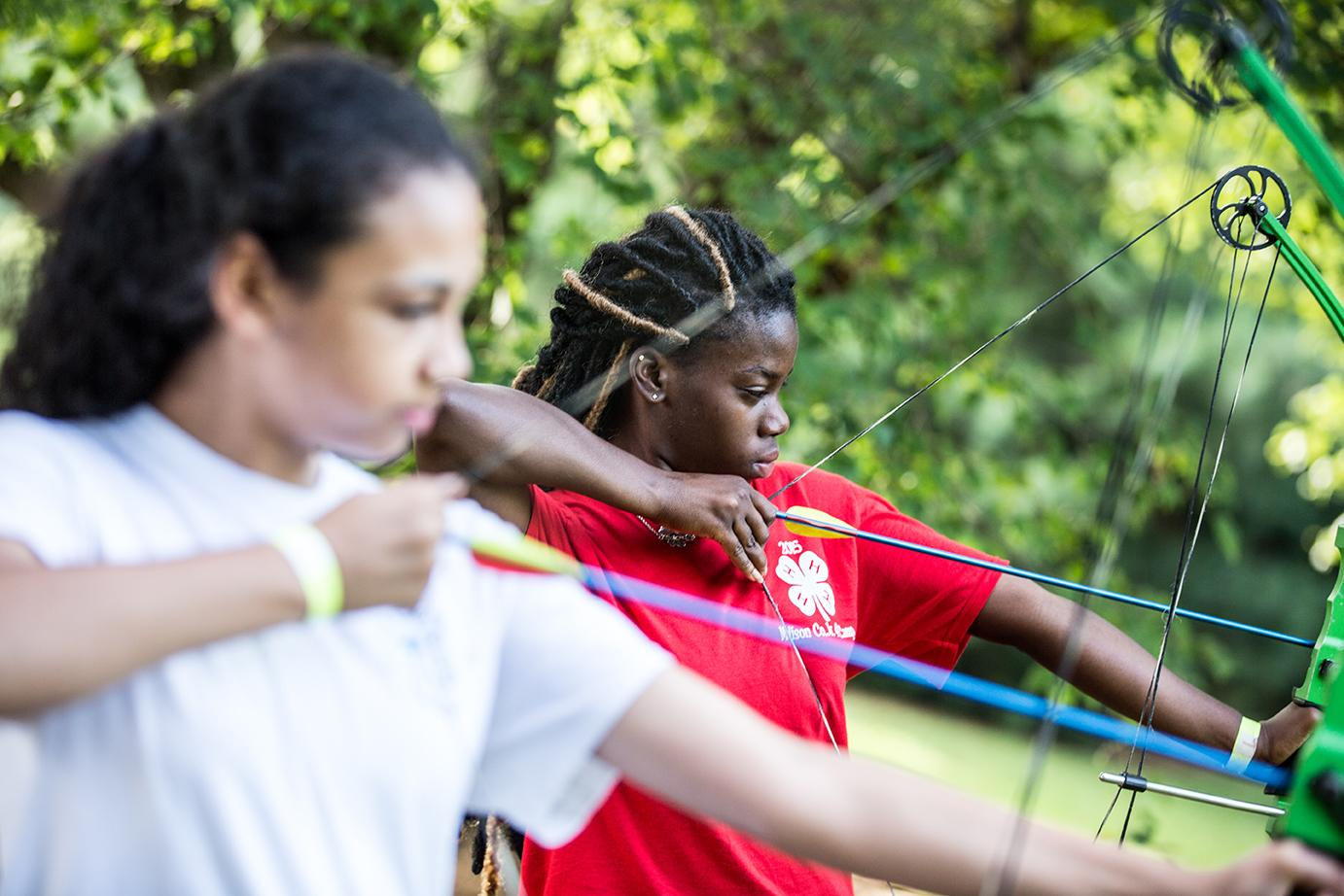 girls practicing archery
