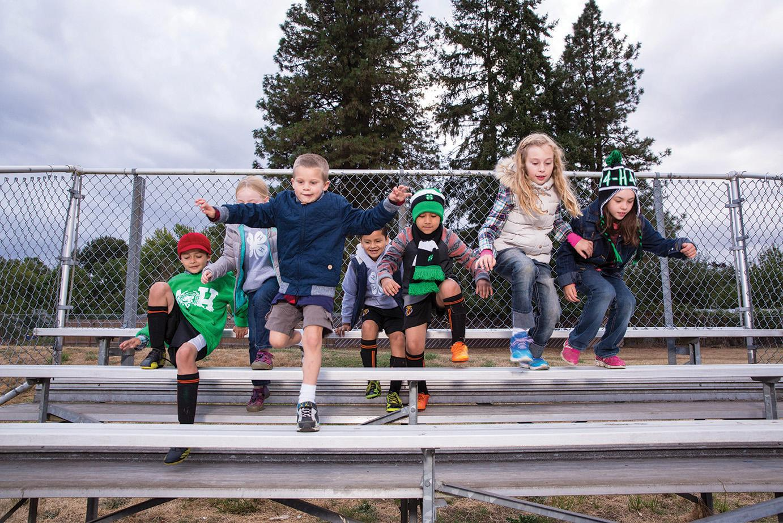 children running down bleachers