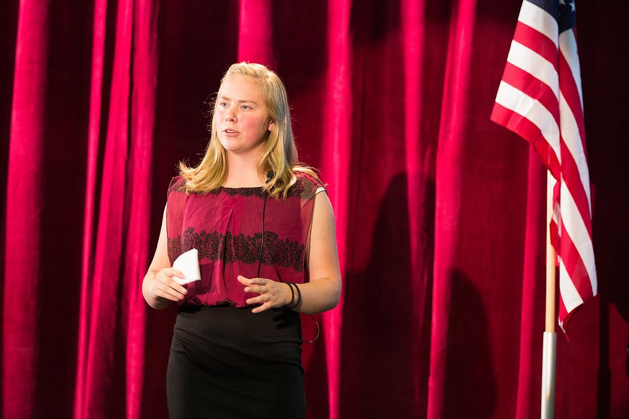 teen delivering presentation on stage