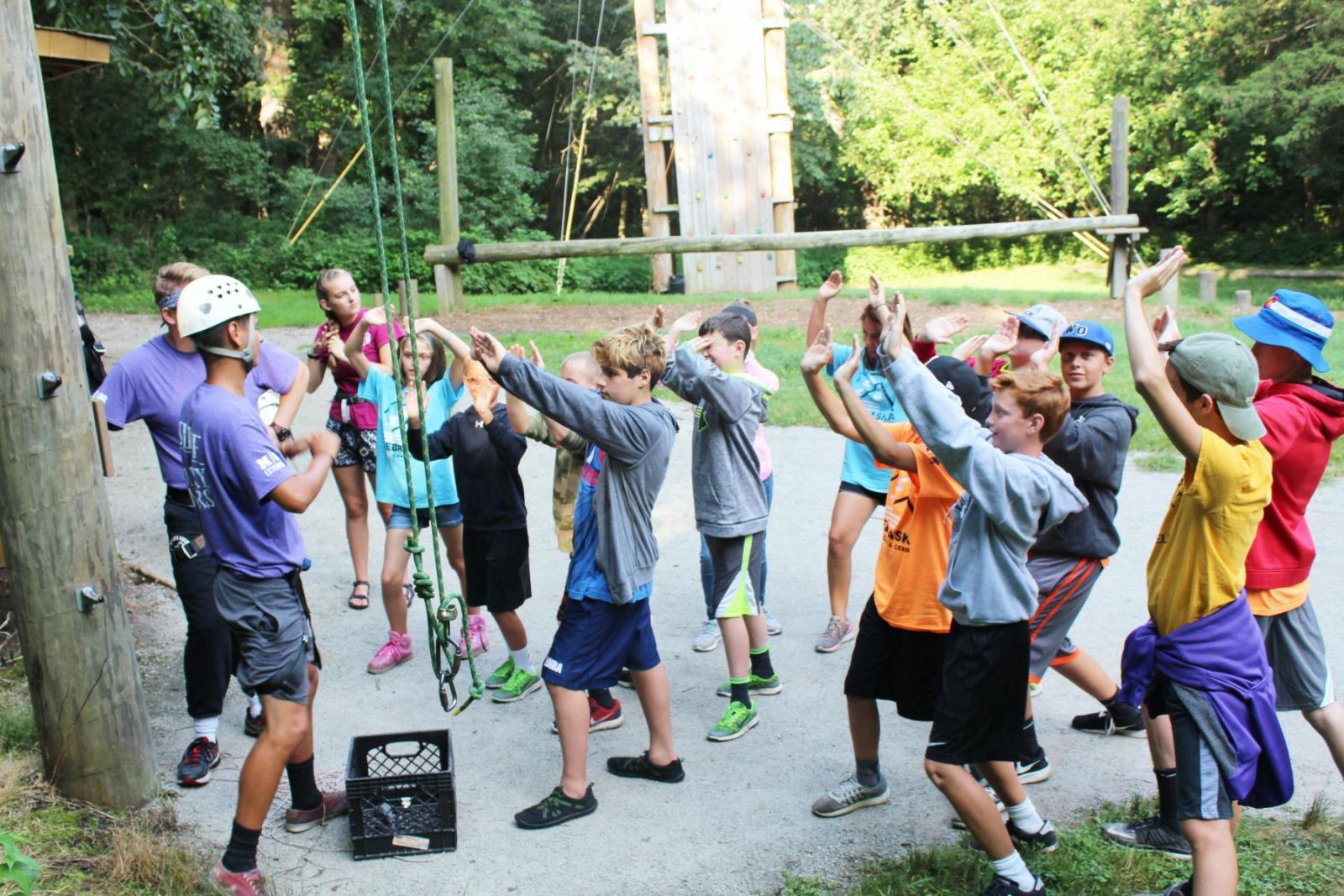 children standing around camp staff
