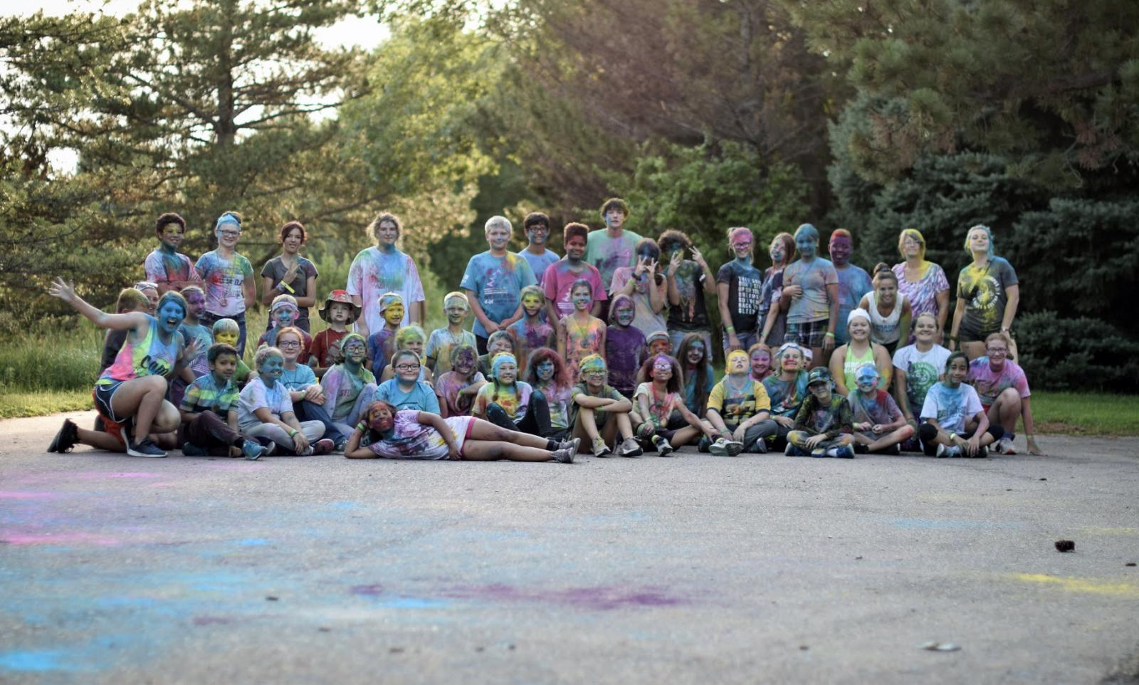 campers covered in colored powder making silly faces